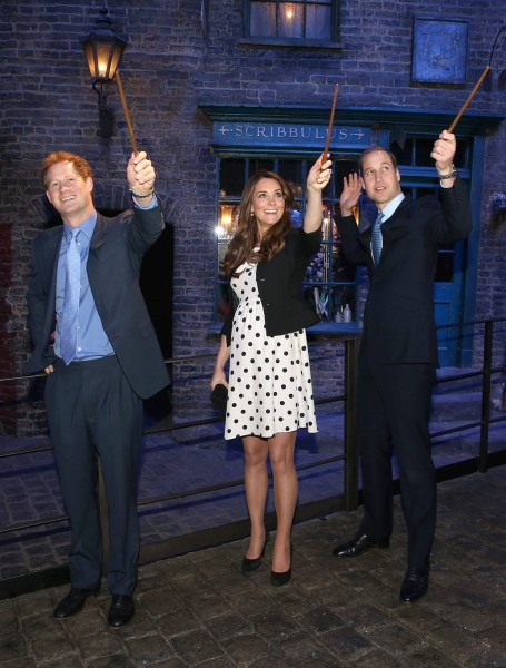 LONDON, ENGLAND - APRIL 26:  Prince Harry, Catherine, Duchess of Cambridge and Prince William, Duke of Cambridge raise their wands on the set used to ...