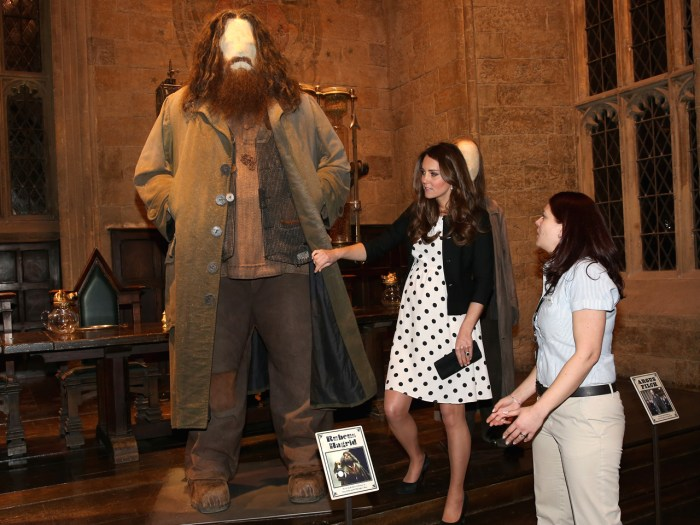 LONDON, ENGLAND - APRIL 26:  Catherine, Duchess of Cambridge looks at the costume for the character Hagrid on display on the set used to depict Hogwar...