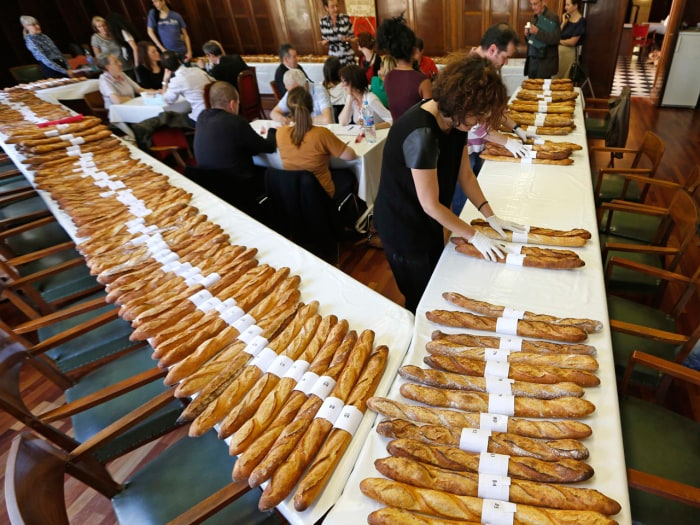 Jury members taste and select baguettes, French bread, which compete for the 'Grand Prix de la Baguette de la Ville de Paris' (Best Baguette of Paris ...