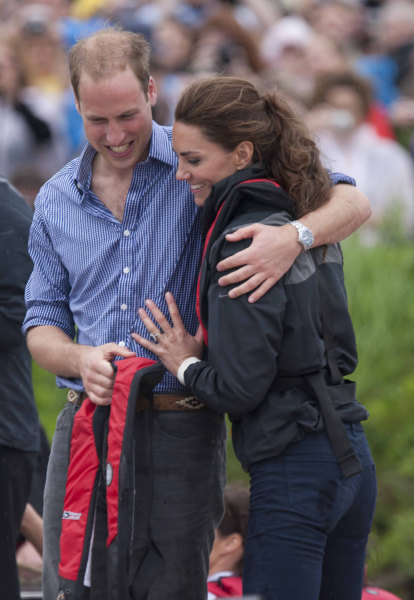 CHARLOTTETOWN, PE - JULY 04:  (NO UK SALES FOR 28 DAYS) Prince William, Duke of Cambridge and Catherine, Duchess of Cambridge hug after taking part in...