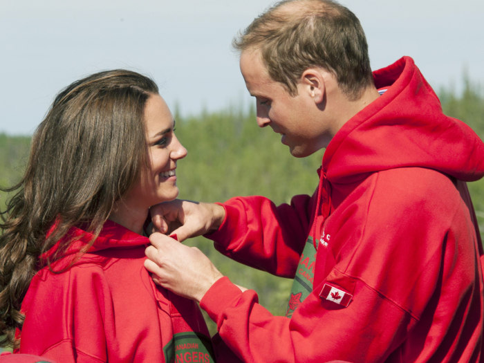 BLACHFORD LAKE, NT - JULY 05: Prince William, Duke of Cambridge and  Catherine, Duchess of Cambridge try on red jackets as they visit the Canadian Ran...