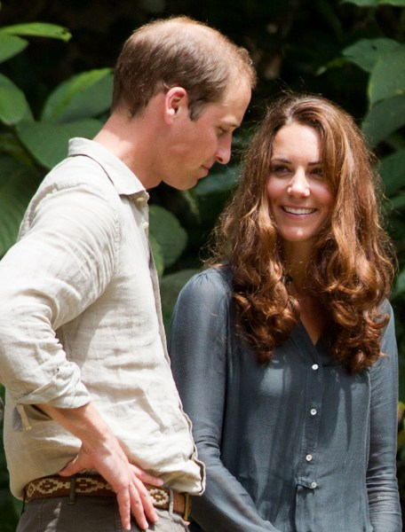 Britain's Prince William (L) and Catherine, the Duchess of Cambridge (R), speak to each other during their visit at the Borneo Rainforest Lodge in Dan...