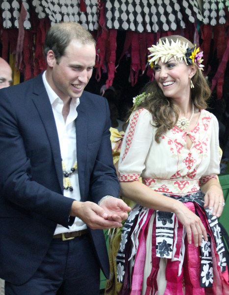 Britain's Prince William (L) and his wife Catherine (R), the Duchess of Cambridge, attend a 'fatale', a singing and dancing event, in Funafuti on Tuva...