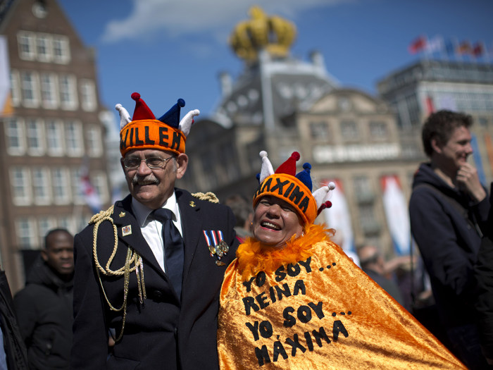 Couple Reina Reyes and Asdrubal Medina  from Venezuela pose for a photograph outside the Royal Palace in downtown Amsterdam, in downtown Amsterdam, Ne...