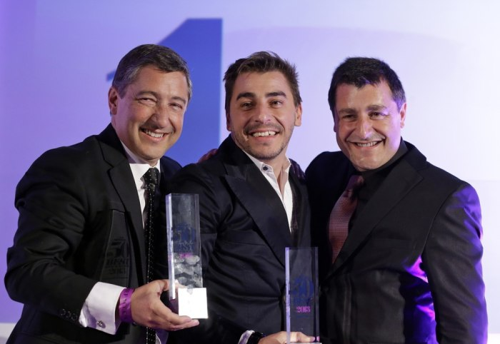 Head chef Joan Roca, left, accompanied by his brothers Jordi Roca, center, and Josep Roca, right,  pose for the photographers with their trophies afte...