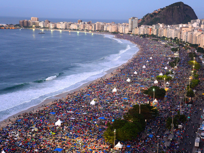 Crowds gather on Copacabana beach in Rio de Janeiro for the final mass of the pope's week-long visit.