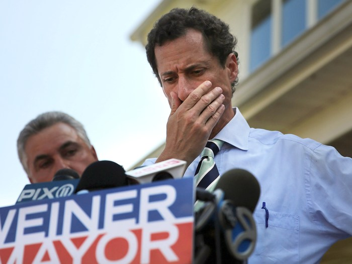 Anthony Weiner pauses while speaking with reporters in Staten Island on a visit to homes damaged by Hurricane Sandy on July 26, 2013.