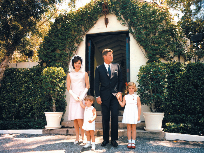 In 1963, the first family stuck with tradition and attended East Mass at Palm Beach's vine-covered St. Edward's Church.
