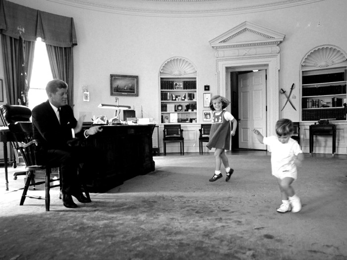 """Buttons! John! John!"" The Kennedy children came running to the Oval Office as soon as they heard Daddy clap his hands. With publicity-wary Jackie riding horses in Virginia, JFK felt free to invite photographers in to snap away."