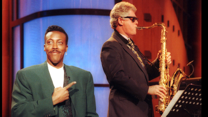 "Gov. Bill Clinton, sitting with the band, turns out an impressive version of ""Heatrbreak Hotel"" as Arsenio Hall gestures approvingly in the musical op..."