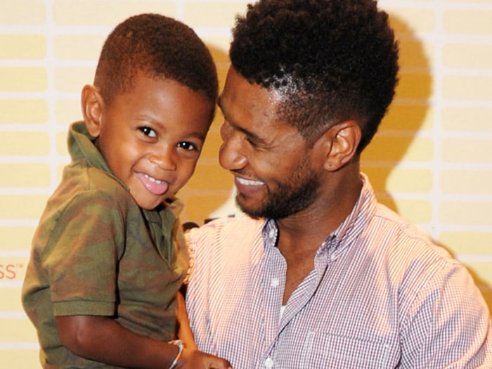 Usher and his son, Usher Raymond V, attend a conference for the singer's foundation in Atlanta on July 21.