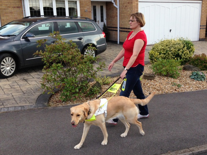 Claire Johnson is seen here with her blind guide dog.