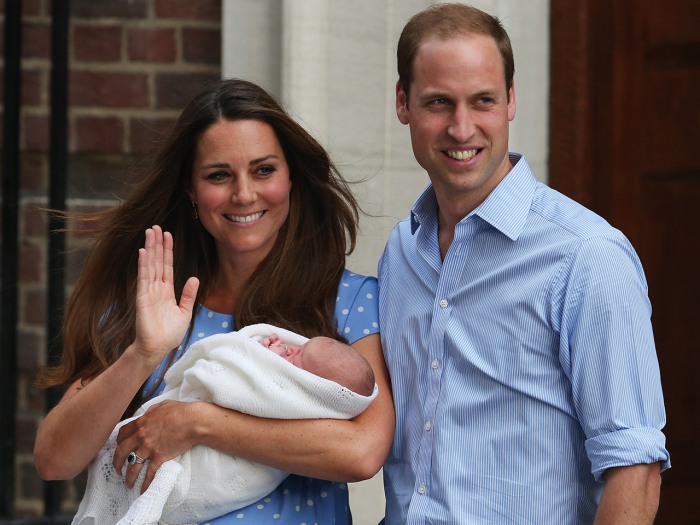Prince William and Duchess Kate pose with their newborn son before the crowds at St. Mary's Hospital on July 23, 2013 in London, England.