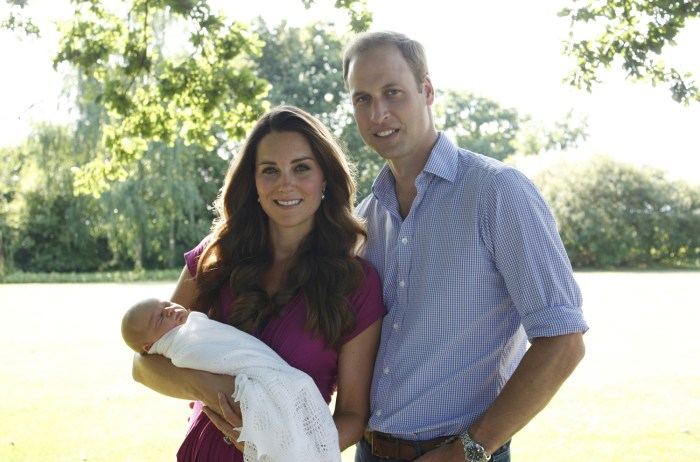 Prince William and Duchess Kate hold their newborn son, Prince George, at Kate's family's Bucklebury estate. The intimate photograph was taken by Kate's father, Michael Middleton.