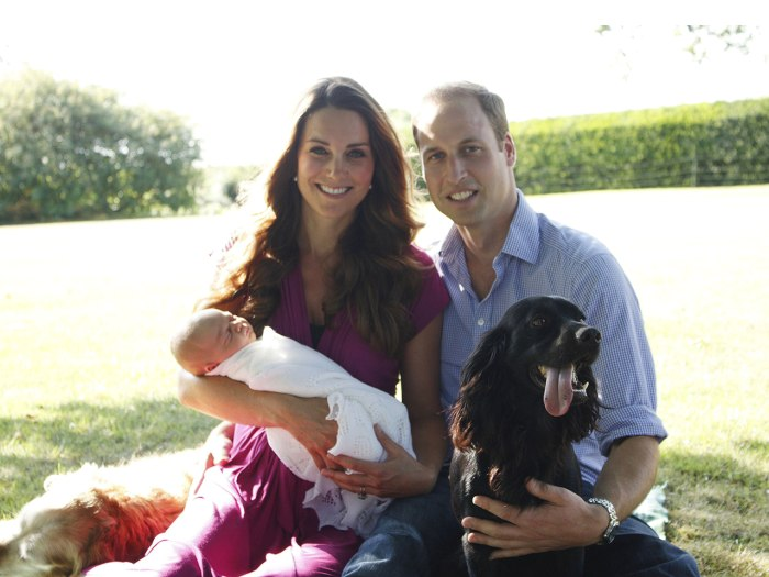 Prince William and Duchess Kate hold their newborn son, Prince George, at Kate's family's Bucklebury estate. Instead of a professional photographer, the couple used Kate's father, Michael Middleton.
