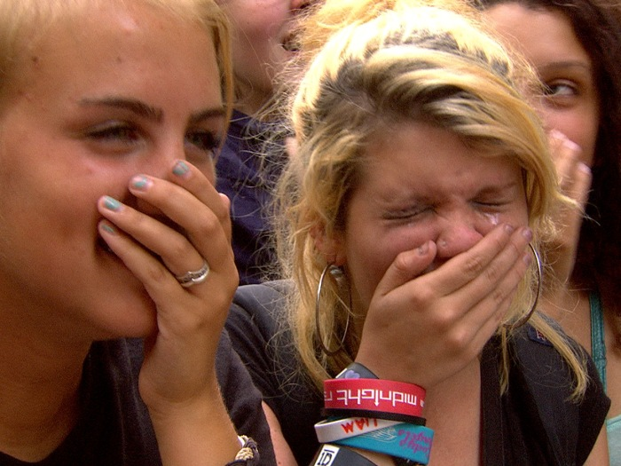 A fan cries while watching One Direction perform on TODAY.