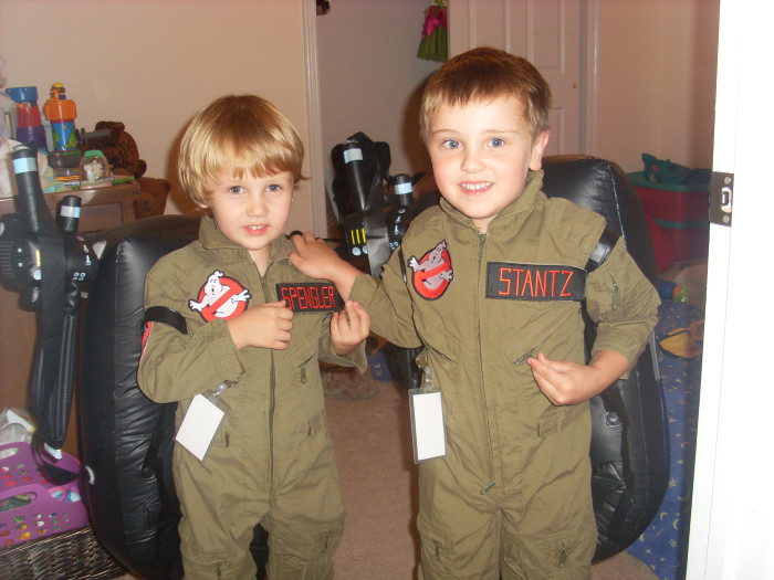 "Elliott Dash, left, and his older brother Oliver Dash pose in their favorite outfits: ""Ghostbusters"" suits."