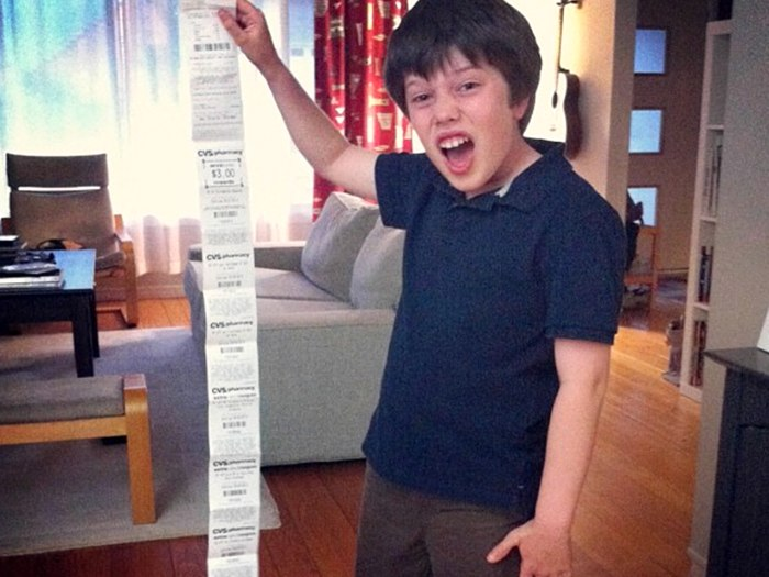 CVS blames its 'love of savings' for receipts that are sometimes taller than small children.