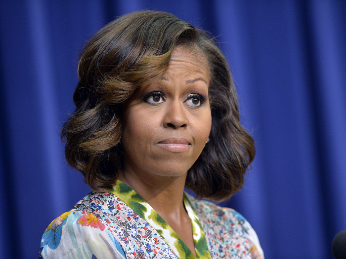 UFirst lady Michelle Obama and the golden highlights she has been sporting since growing out those famous bangs.