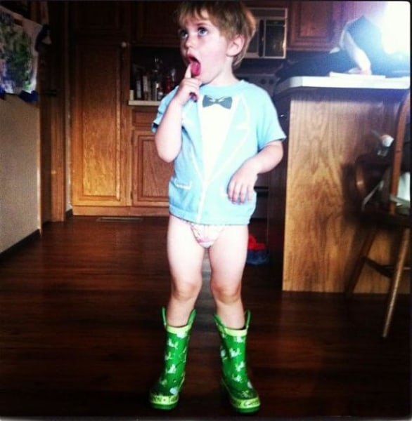 Three-year-old Joshua Latham of Red River, N.M., strikes a pose in a tuxedo T-shirt and wellies.