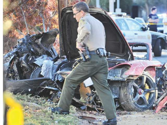 Image: Police officer at scene of crash which killed actor Paul Walker