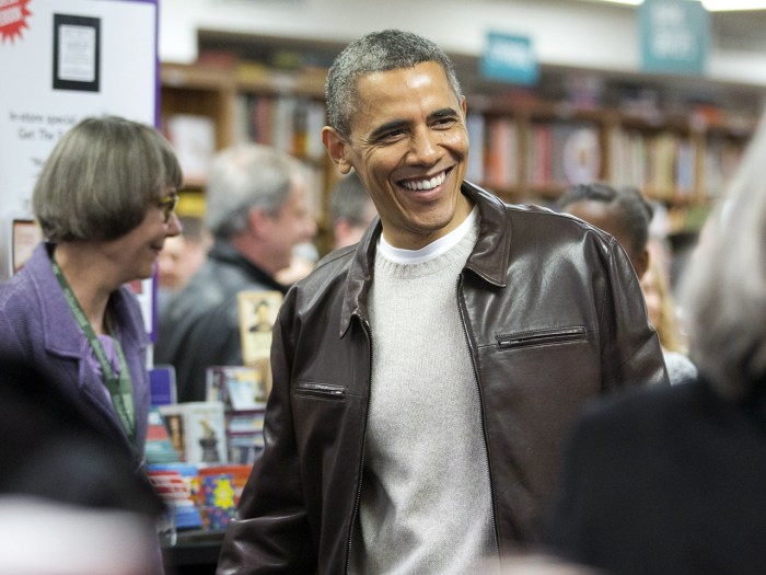 President Barack Obama greets shoppers as he shops at the local bookstore Politics and Prose in northwest Washington, Saturday, Nov. 30, 2013.  (AP Ph...