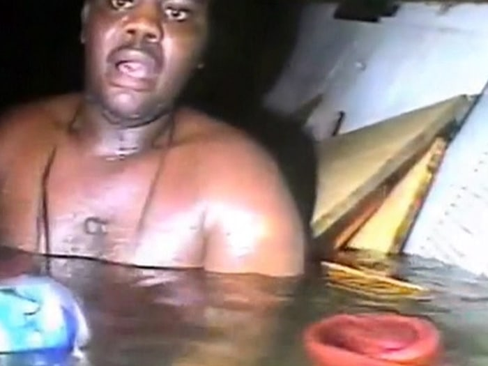 The head lamp of the rescue diver illuminates Okene, who survived on sips of Coca-Cola in only his underwear in the freezing cold water after the ship he worked on capsized in the Atlantic Ocean off the coast of Nigeria.