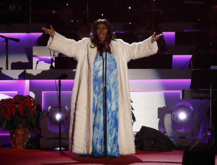 Singer Aretha Franklin performs at the National Christmas Tree lighting ceremony attended by President Barack Obama across from the White House in Was...