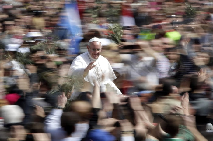 Pope Francis waves as he leaves after the Palm Sunday mass at Saint Peter's Square at the Vatican March 24, 2013. REUTERS/Max Rossi (VATICAN - Tags: R...
