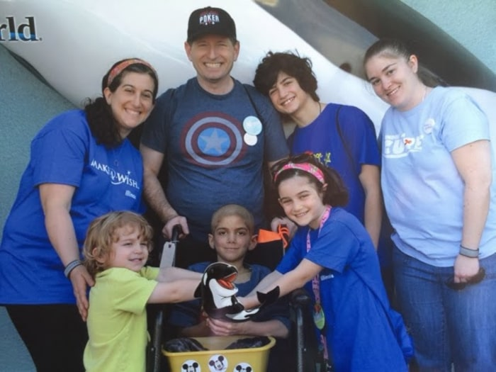 "Sam Sommer and his family at Disney World, a trip they took thanks to the Make A Wish Foundation and Sam's other ""wish granters."" His mother Phyllis has been chronicling his fight against the illness on her blog."