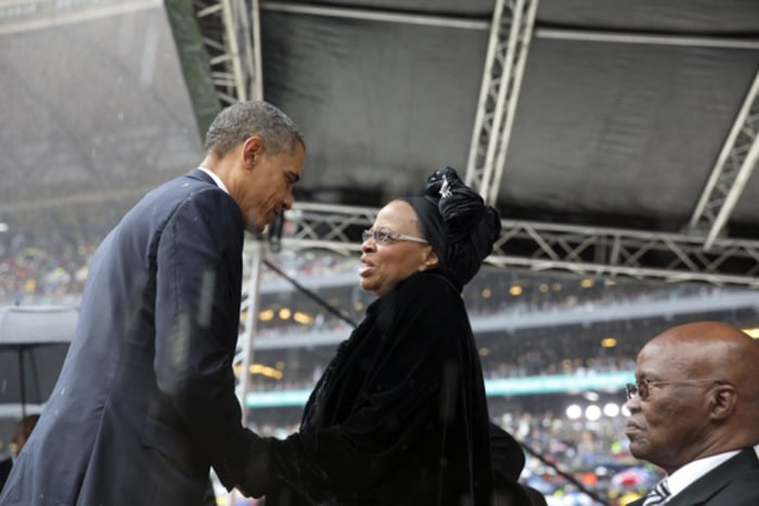 President Obama greets Graca Machel, Nelson Mandela's widow, after his speech at the memorial service