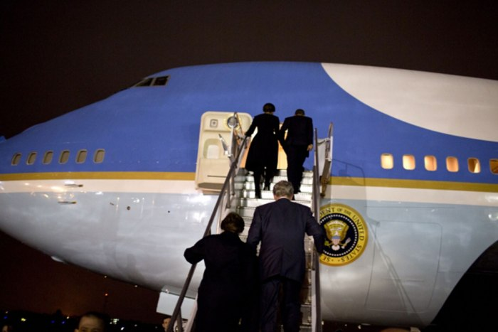 Laura and George W. Bush and Michelle and Barack Obama board Air Force One in Johannesburg.