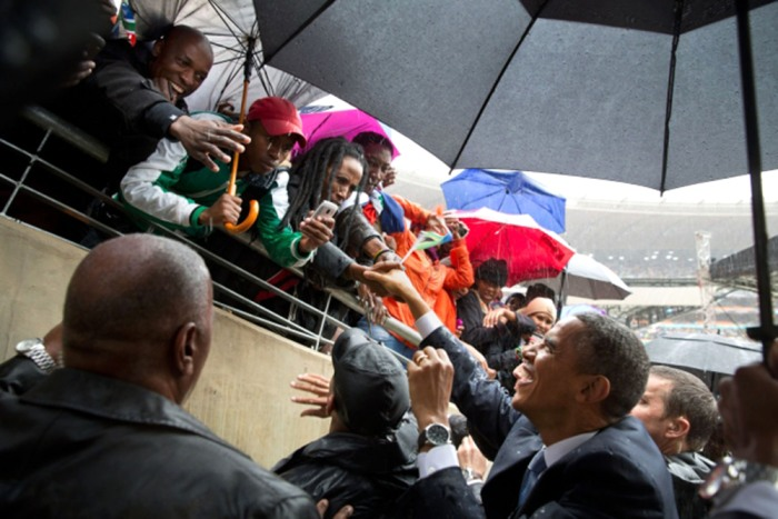 President Obama greets South Africans as he exits the field of the soccer stadium.
