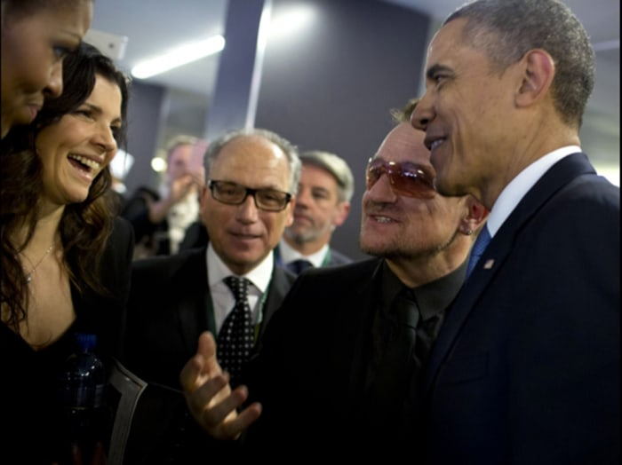 Bono greets President and Mrs. Obama as they get ready to depart the memorial service.