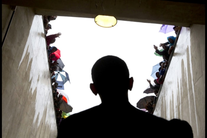 South Africans cheer as President Obama waits in a tunnel at the soccer stadium before taking the stage to speak at Nelson Mandela's memorial service.