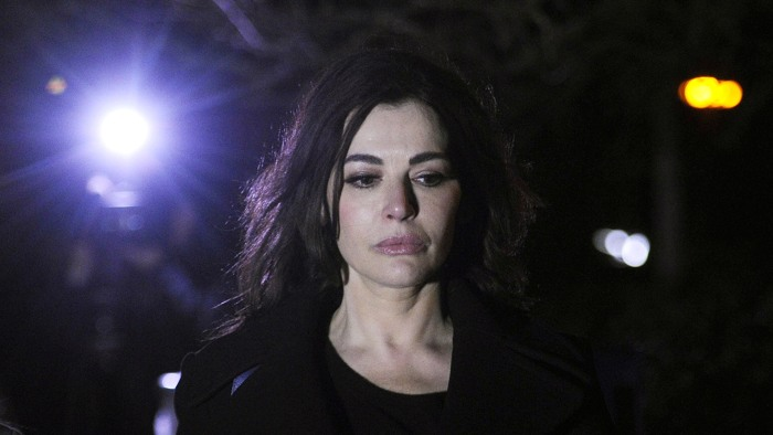 British journalist, broadcaster, and television chef Nigella Lawson leaves Isleworth Crown Court in London on Dec. 5.