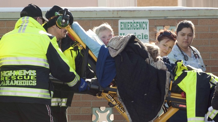 Members of a family that went missing are wheeled by stretcher from an ambulance into the Pershing General Hospital in Lovelock, Nevada, December 10, ...