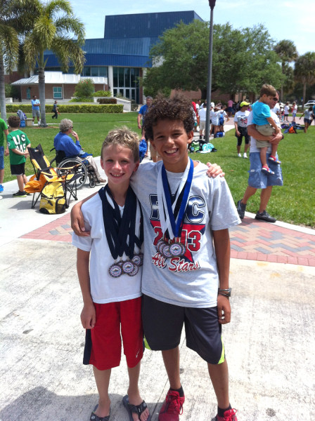 Florida swimmer Josh Zuchowski, 9, (at left) gave his trophy as the top swimmer in a meet earlier this month to rival Reese Branzell, 10, (at right) after Branzell had been hospitalized and could not compete.