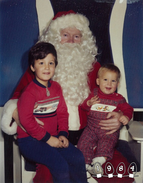 Like most kids, the Gray brothers sat on Santa's lap for a Christmas photo. Unlike most, they kept that tradition going...