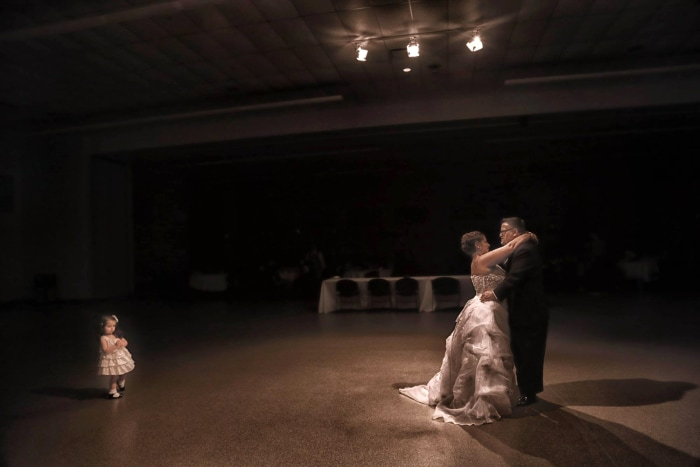 The couple dances at their wedding.
