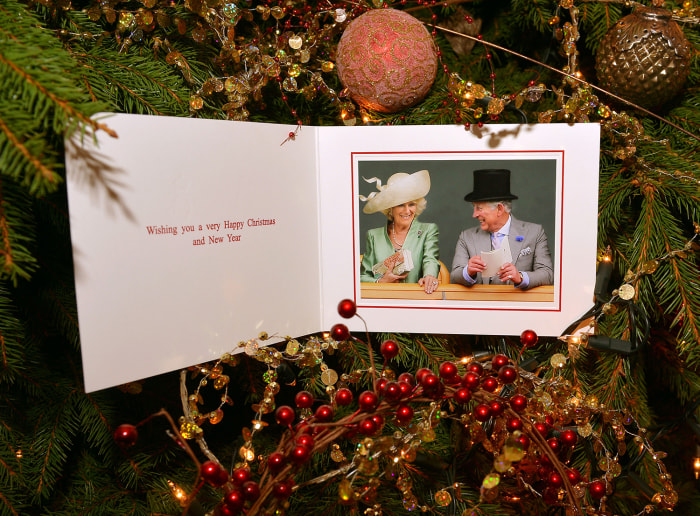 The card reads 'Wishing you a very happy Christmas and New Year.' The inside of the Prince of Wales and the Duchess of Cornwall's 2013 Christmas card with a photo by Stephen Lo...
