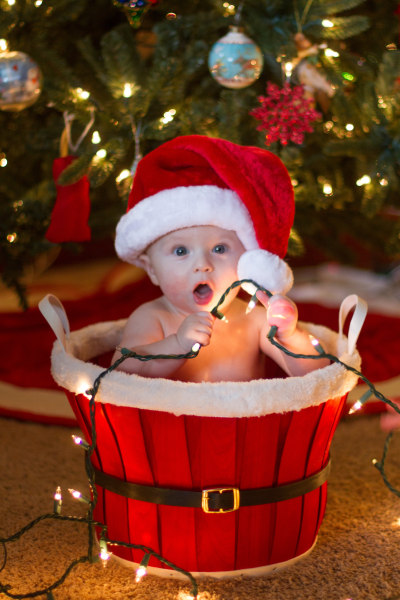Brayden James, born Apr. 13, helps his parents light up the holidays.