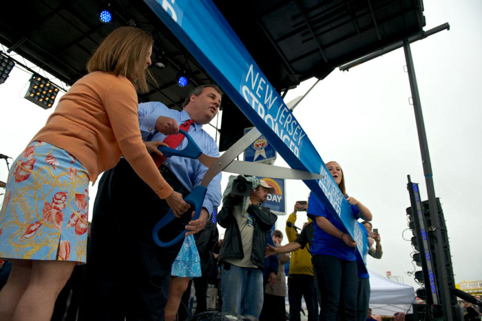 New Jersey Gov. Chris Christie cuts a ribbon more than five miles long at the Memorial Day Weekend re-opening ceremony of the Jersey Shore.