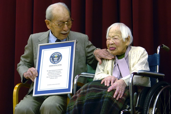 Misao Okawa is joined by her 90-year-old son, Hiroshi