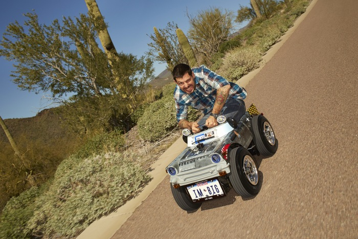 Austin Coulson, the Guinness record holder for 'Smallest Roadworthy Car.'