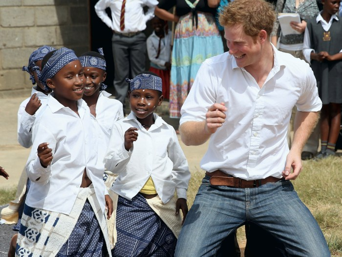 MASERU, LESOTHO - FEBRUARY 27: Prince Harry dances with deaf children during at visit to the Kananelo Centre for the deaf, a project supported by his ...