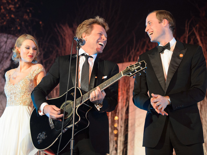 Britain's Prince William, the Duke of Cambridge, right, sings with US singers Taylor Swift, left, and Jon Bon Jovi at the Centrepoint Gala Dinner at K...