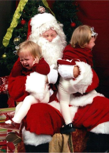 "Angela Brown ElliotTODAY Moms This is a true ""Scared of Santa"" photo but Santa is just as sclared of my twins - one who was swinging punches at him. Allison and Isabel Elliot were 18 months old in this 2011 photo."