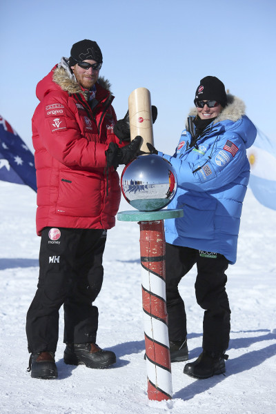 Prince Harry (L) poses for a photograph with Margaux Mange of Team U.S. at the South Pole in this December 13, 2013 handout from Walking With the Woun...