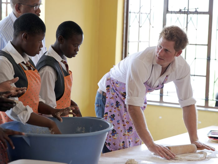 Britain's Prince Harry bakes at the Kananelo Centre for the Deaf on February 27, 2013 in Maseru. Prince Harry visited his charity projects in Lesotho ...